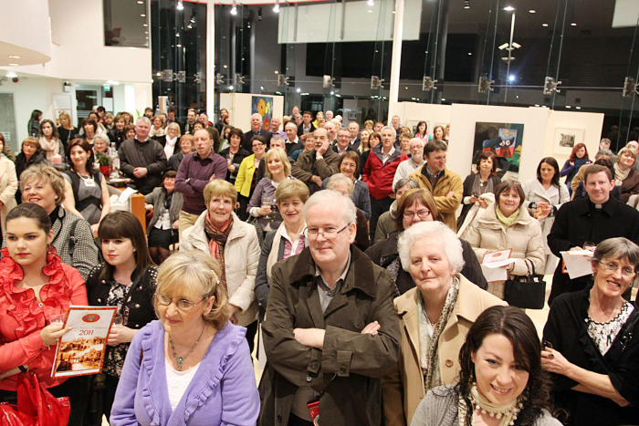 A section of the large attendance at the official opening of the Kanturk Arts Festival in O'Callaghan's Toyota, Kanturk. Photo by Patrick Casey